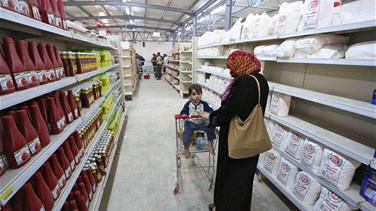 At Zaatari camp supermarket, Syrian refugees shop with blink of an eye