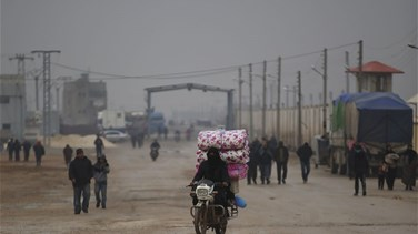 Syrian rebels hand border crossing to opposition government