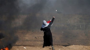 Israeli fire kills one Palestinian, wounds 170 in border protest-Gaza medics