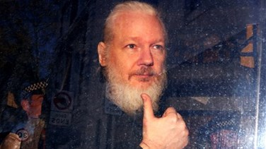 "Assange suffering psychological torture, would face ""show trial"" in US - UN expert"