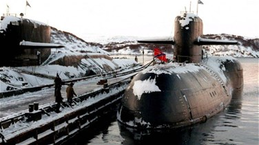 Russia, after three days, says submarine hit by fire was nuclear-powered