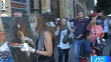 Artists create revolutionary paintings in central Beirut (Video)